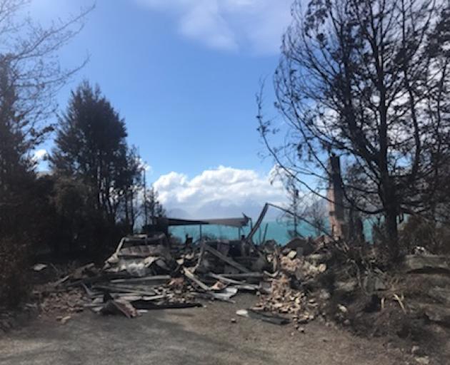 Several homes have been destroyed by the fire. Photo: Daisy Hudson