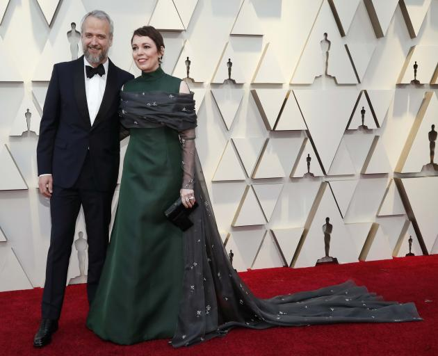 Olivia Colman and husband Ed Sinclair pose. Photo: Reuters