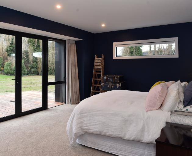 The master bedroom is painted midnight blue. ''I wanted our room to be sort of masculine but...
