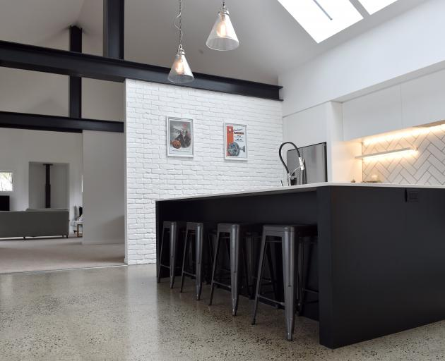 A polished concrete floor and imitation brick walls give the kitchen an industrial feel.
