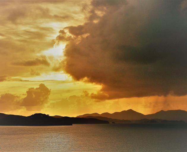 A golden sunrise over Moturua and Urupukapuka Islands and the Rawhiti headland. PHOTO:BRUCE MUNRO...