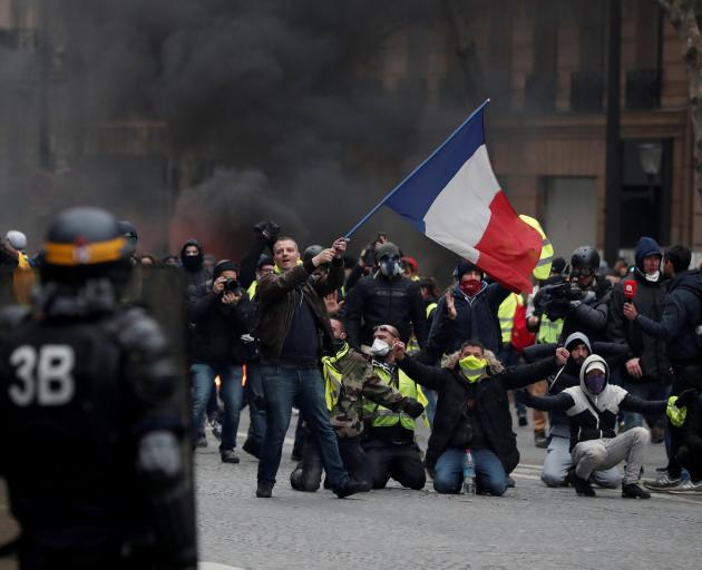 Authorities say 136,000 people had taken part in protests across France on Saturday, including 10...