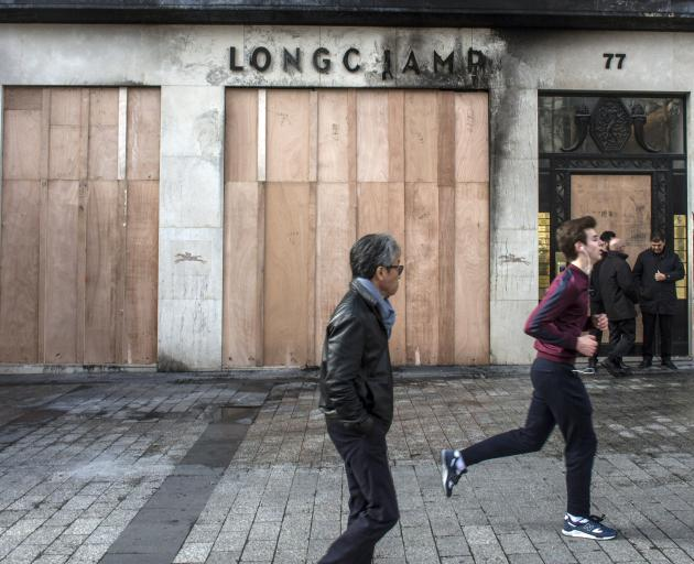 Luxury stores along one of Paris' most famous streets were targetted. Photo: AP