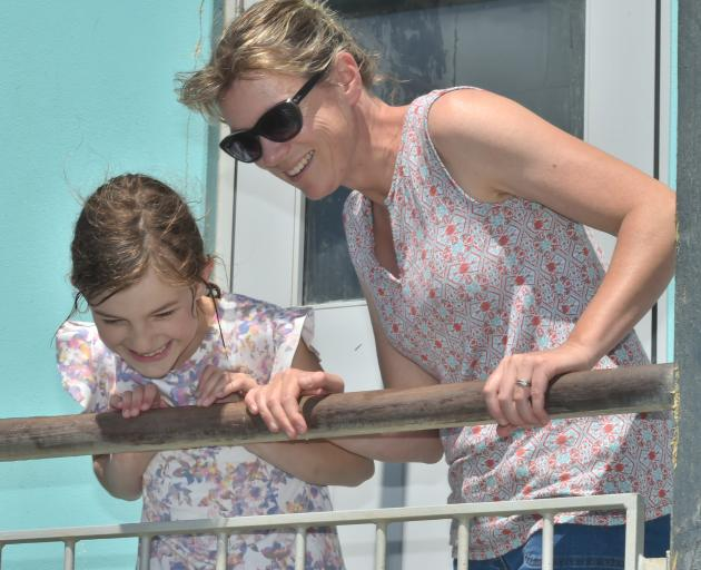 Nina (10) and Deb Carstens watch the penguin at St Clair's Hot Salt Water Pool. Photo: Gregor...