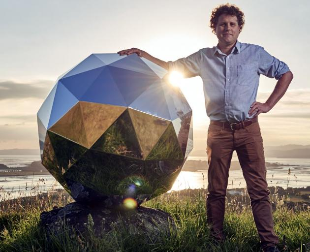 Rocket Lab founder Peter Beck with 'Humanity Star', New Zealand's first satellite. Photo: supplied