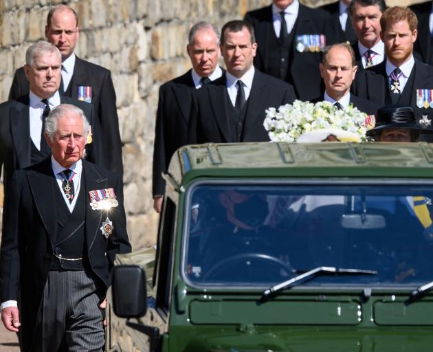 Heir to the throne Prince Charles (left) leads members of the royal family as they walk behind a...