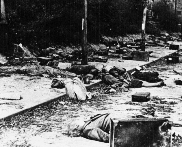 Dead German civilians after  a bombing raid. New Zealand squadrons  nearly always flew with...