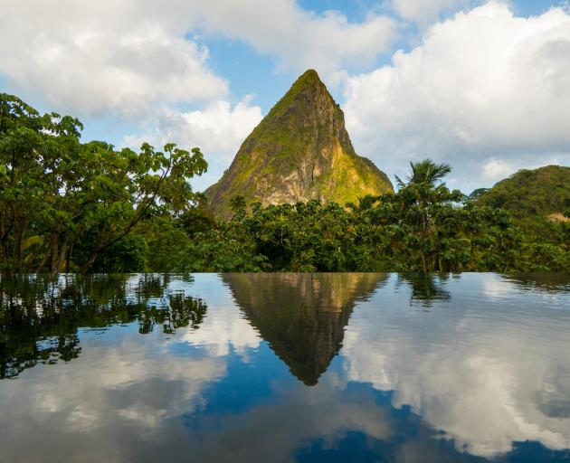 The pool beneath the Hotel Chocolat Boucan's restaurant reflected Petit Piton perfectly in the...