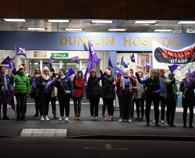 Nurses picket the front entrance of Dunedin Hospital this morning as their 24-hour strike started...