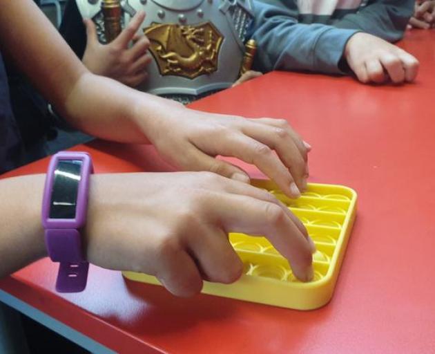 Children find the Pop-Its' sound satisfying. Photo: Robin Martin
