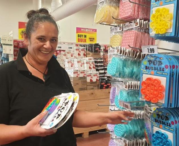 Pam Evans, from Uncle Bills in New Plymouth, says Pop-Its sell out as soon as they go on the...