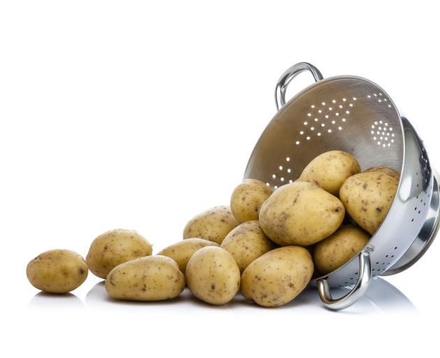 Potatoes in colander. Photo: Getty Images