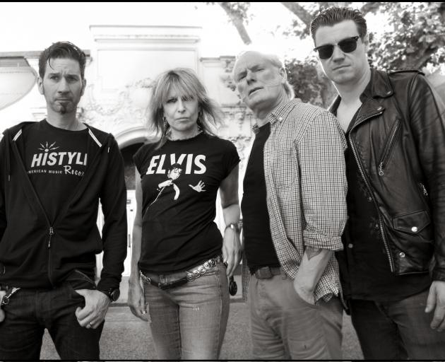 The current Pretenders line-up of bassist Nick Wilkinson, Chrissie Hynde, drummer Martin Chambers...