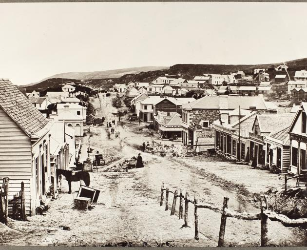 Princes St, Dunedin in 1860. By this time the centres of Pakeha towns were beginning to change....