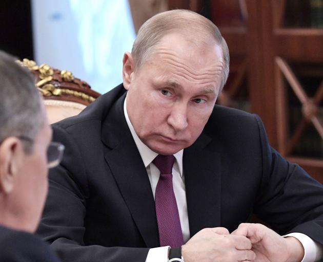 President Vladimir Putin meets with  Foreign Minister Sergei Lavrov at the Kremlin on Saturday.