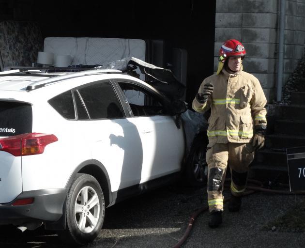 A firefighter assesses the damage. PHOTO: JOSHUA WALTON