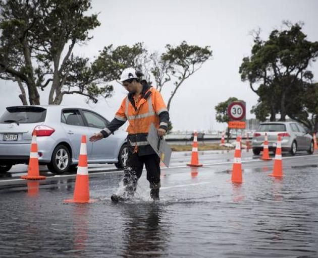 Rain combined with a king tide closed part of Tamaki Dr on Auckland's waterfront this morning....