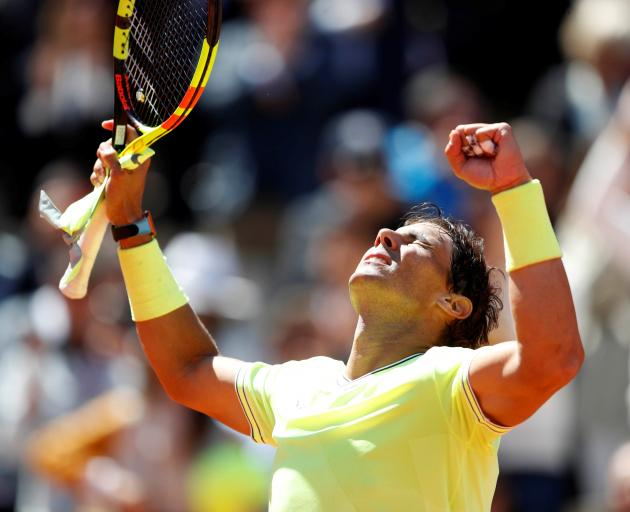 Rafael Nadal celebrates his straight-sets win over Roger Federer on Friday. Photo: Reuters