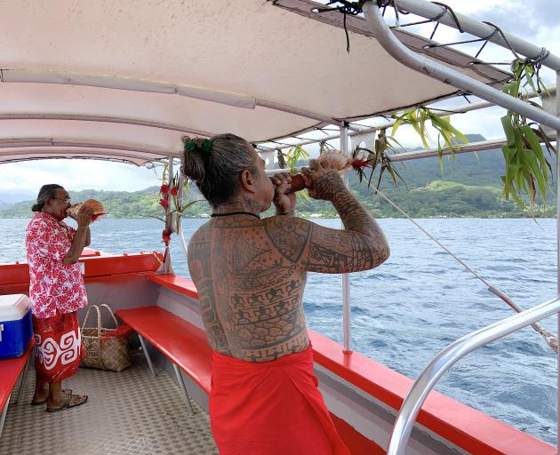 A conch shell trumpet duet from Tihoti and his uncle, Heimau.