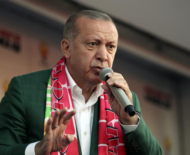 Recep Tayyip Erdogan addresses supporters during a rally in Antalya on Saturday. Photo:...