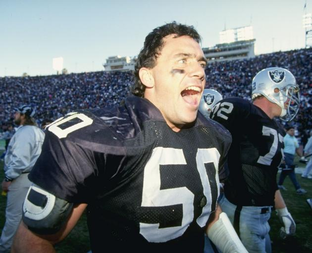 Ellison celebrates in 1990 when the Los Angeles Raiders beat the San Diego Chargers. Photo: Getty...