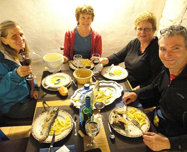 Sue Duthrie (second from right) enjoys a fish and chip supper at an albergues (pilgrim hostel)...
