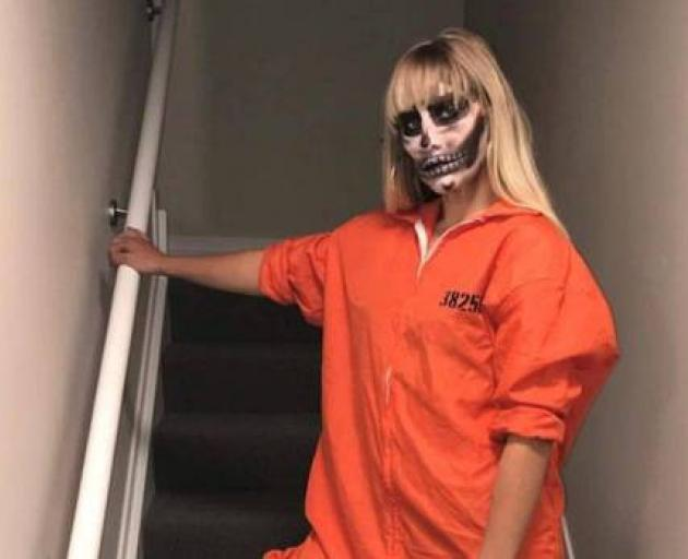 Rouxle Le Roux posted a picture of herself wearing an orange prison jumpsuit on Instagram. Photo:...