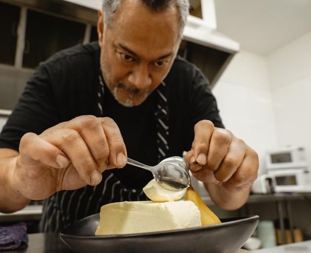 Faigan's Cafe & Store chef Vern Samu plates up a piece of cheesecake. PHOTO: REBECCA FOX