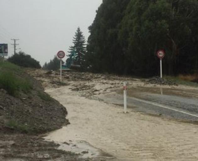 SH8 near Roxburgh has been covered in mud. Photo: Robin Fox Berthault