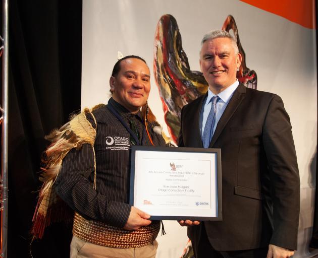 Minister of Corrections Kelvin Davis congratulates Rue-Jade Morgan at the Arts Access Aotearoa...