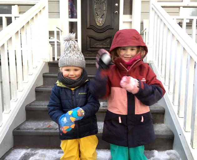 Harry (3) and Ada Christie (5) in Maryhill, Dunedin this morning rugged up to the hilt for kindy and school on a snowy Tuesday morning. Photo: Christine O'Connor