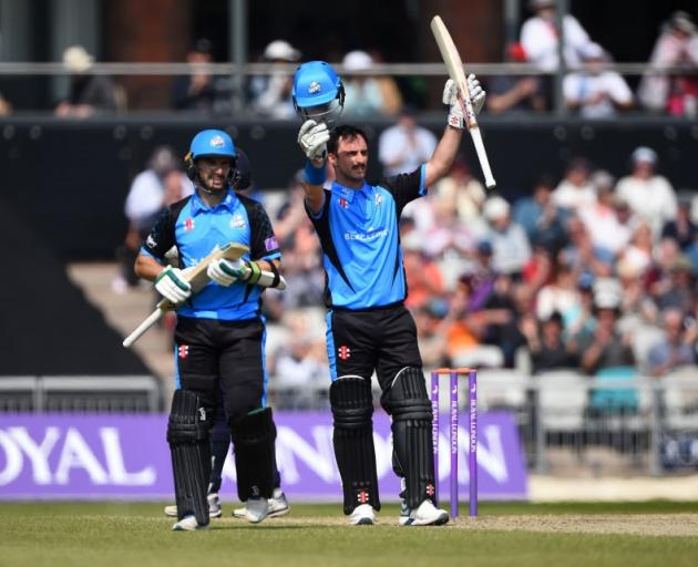Hamish Rutherford raises his bat after scoring a century for Worcestershire at Old Trafford....
