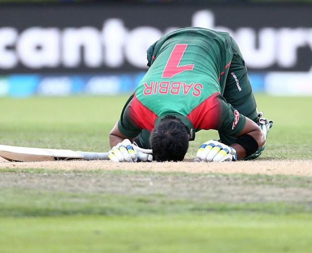 Sabbir Rahman Roman celebrates his century at the University Oval earlier today. Photo: Getty...