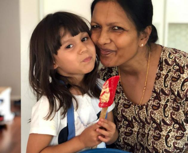 Sai Yoganathan with her granddaughter. Photo: Supplied