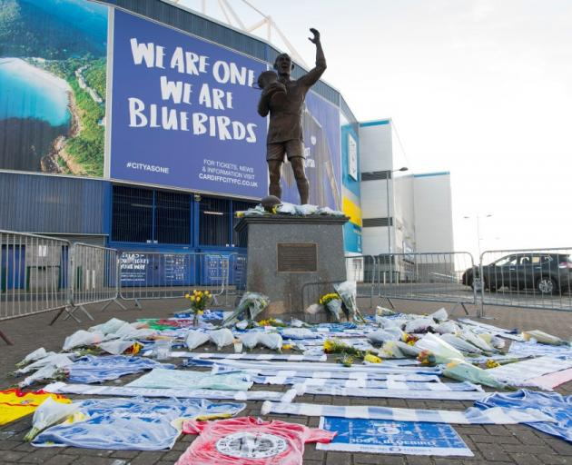Tributes have been left for Emiliano Sala near the Fred Keenor statue at the Cardiff City Stadium...