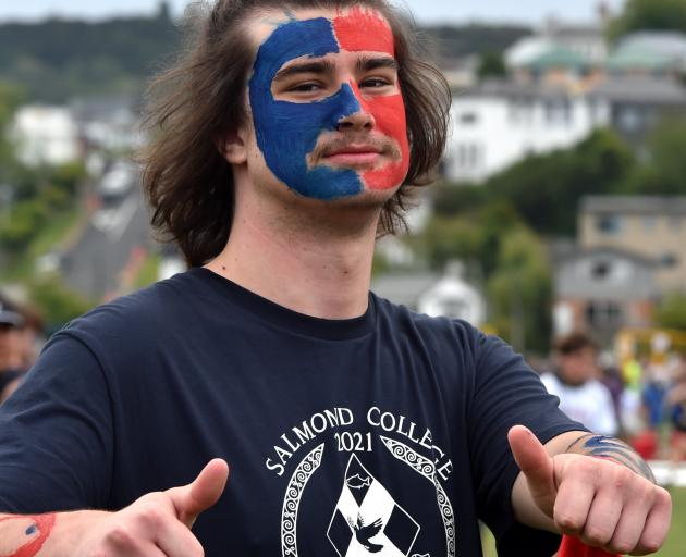 Salmond College resident Jack Elliott (19) shows support for his college.