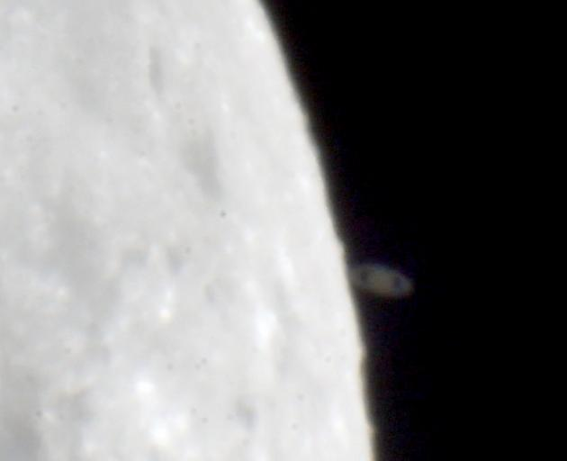 The occulation of Saturn by the moon happened about 12.47am today. Photo: Ian Griffin