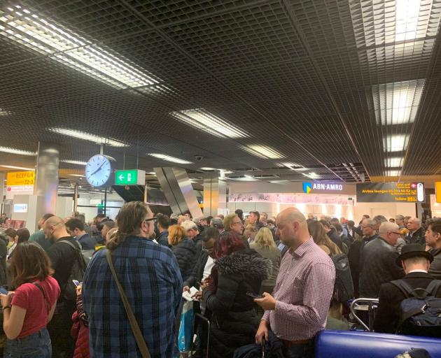 Passengers waiting in Schipol Airport during the security alert. Photo: Mark Crompton via Reuters