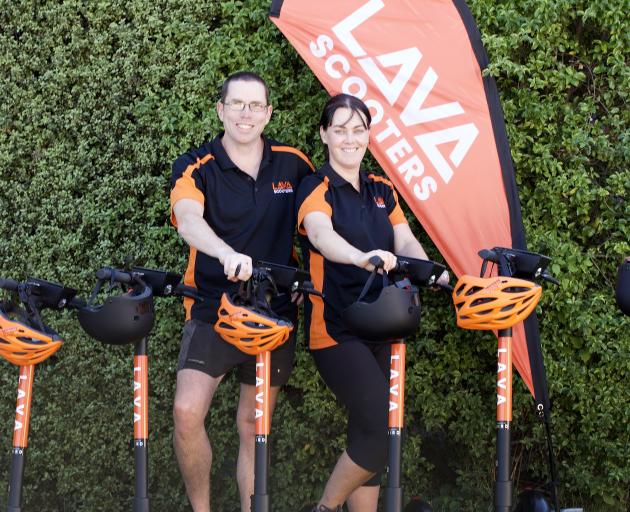 Lincoln residents Phillip and Angela Eberhard with some of their Lava scooters. Photo: Shane Michael
