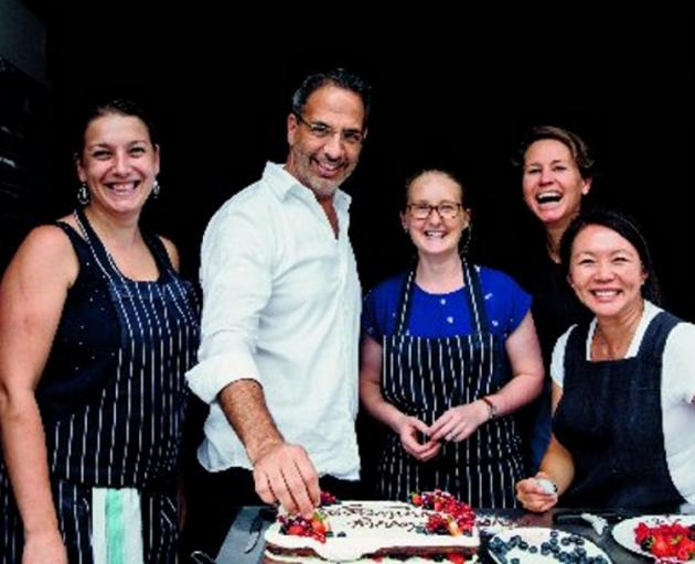 Yotam Ottolenghi with his team of recipe writers, testers and tasters. Photo: Jonathan Lovekin