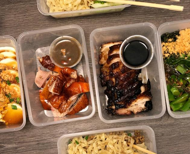 A takeout spread from Fook Kin on Killiney Rd including Cantonese-style barbecue cha siu roast...
