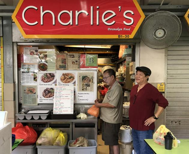 Charlie Tan is one of only a handful of hawkers in Singapore cooking Peranakan food, a cuisine...