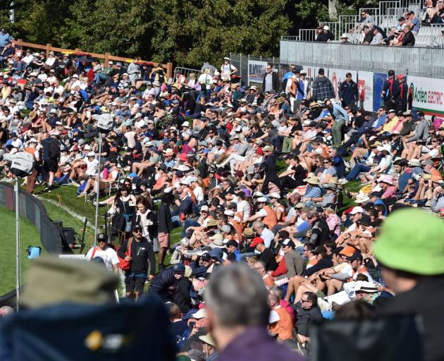 A good crowd turned out to watch the thrilling match at the University Oval. Photo: Peter McIntosh