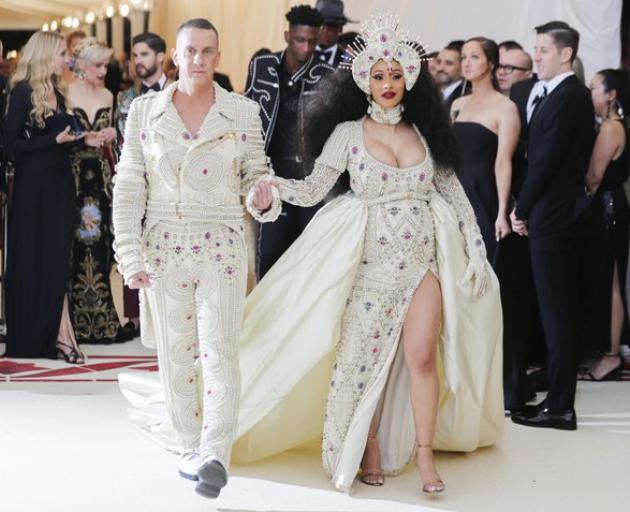Rap star Cardi B attended her first Met Gala wearing a pearl-adorned Moschino dress alongside designer Jeremy Scott. Photo: Reuters