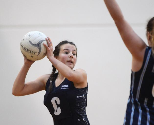 Otago Girls' High School centre Caitlin Thomson prepares to pass the ball. Photos: ODT files