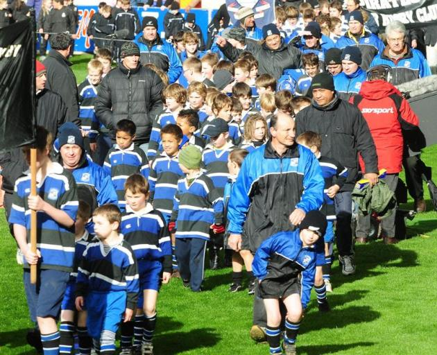 Kaikorai take part in a junior rugby marchpast ahead of the Otago vs Canterbury game on Saturday.