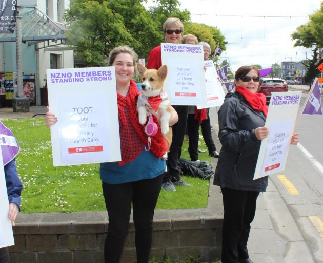 Protesting in Wachner Pl, in Invercargill, yesterday are (from left) Invercargill Medical Centre (IMC) nurses Charlotte Pearce (with dog Pippin) and Jill Tanner and IMC administrator Gabrielle Bulman. Photo: Karen Pasco