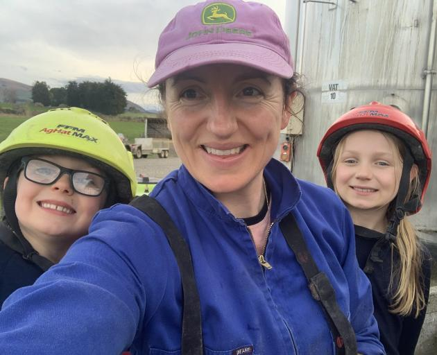 Clinton dairy farmer Madeline Anderson and her two children Beau(7) and Florence (8) take a break...