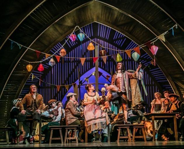 Stephen Chambers (standing on stool) in Landestheater Detmold's production of Zar & Zimmermann