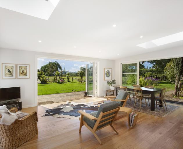 Glass doors on three sides of the extension open to the deck and garden. PHOTO: GEORGIE DANIELL...
